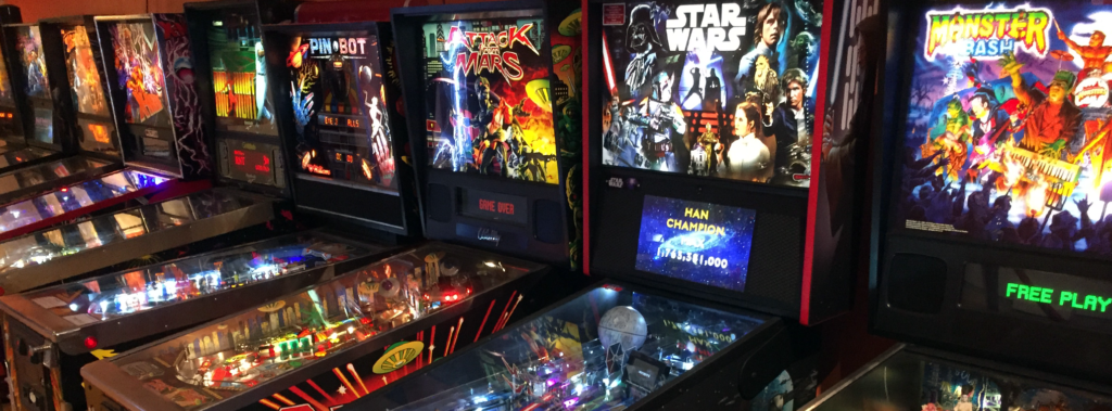 Row of Pinball Machines including Monster Bash, Star Wars, Attack from Mars and Pinbot