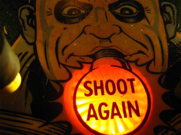 Shoot Again insert on an Addams Family pinball machine featuring Uncle Fester
