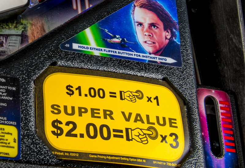 Pricing Card on a Stern Star Wars pinball machine. $1.00 for 1 credit or $2.00 for 3 credits